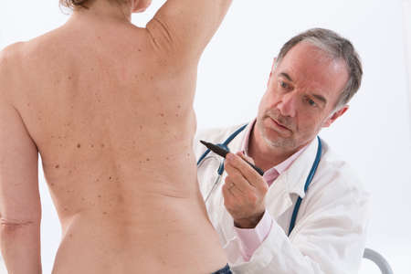 skin cancer: plastic surgery doctor drawing line on patient breast