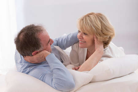 mature adult: Portrait Of Happy Senior Couple Together In Bed