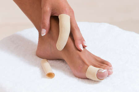 bunion: Foot and hand finger bandage Stock Photo