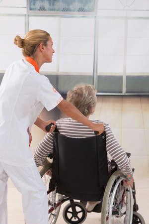 aucasian: disabled senior woman  her nurse