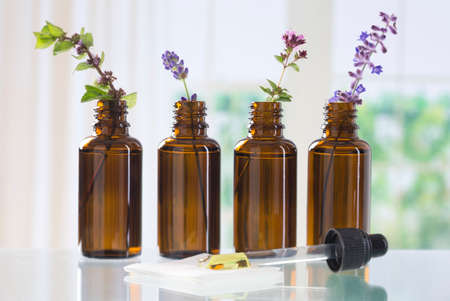 essential oil: brown bottle  with aromatic herbs for essential oil