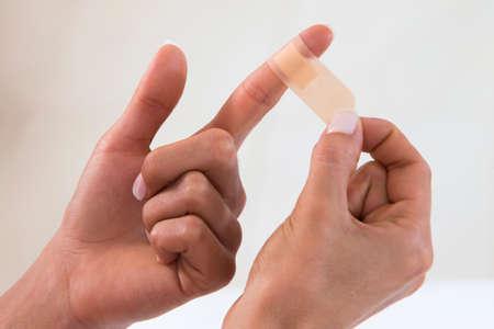 bandage on an injured finger 스톡 콘텐츠