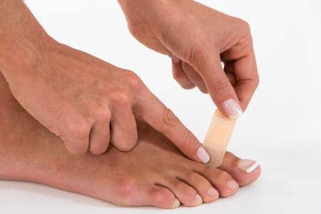plaster foot: finger bandage of a foot