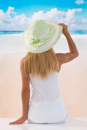 beach view: back view picture of a caucasian  woman enjoying the sea background