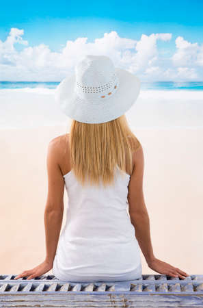 view woman: back view picture of a caucasian  woman enjoying the sea background