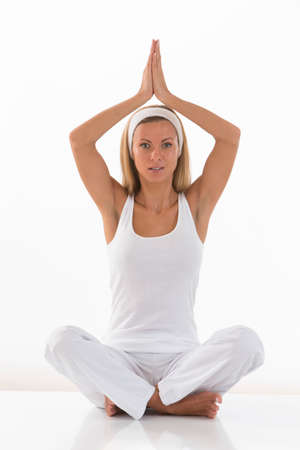 legged: young, woman sitting cross legged in a yoga position a