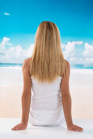 back view: back view picture of a caucasian  woman enjoying the sea background