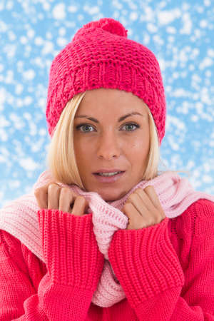 beanies: gorgeous Woman in pink on snowing background