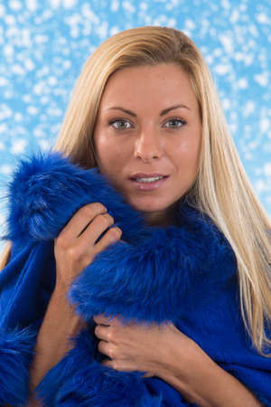 fur: Winter Womanon in blue snow backgroung