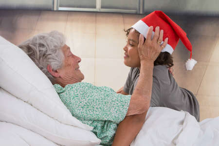 palliative: Grandson Visiting Grandmother  At Home or nursing home at christmas time