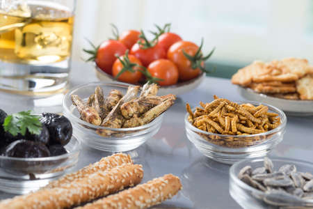 fried bugs abd appetizer biscuit seeds Stock Photo