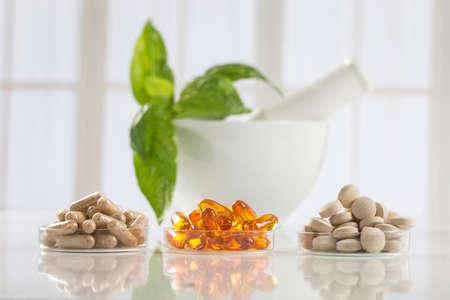 Alternative health care fresh herbal ,dry and herbal capsule with mortar Standard-Bild