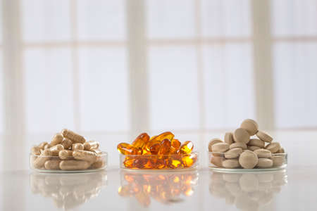 Various dietary supplement capsules and vitamins Stock Photo - 46725291
