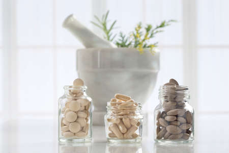 alternative health care: Alternative health care fresh herbal ,dry and herbal capsule with mortar Stock Photo
