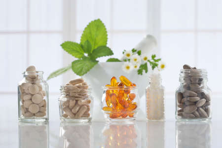 plant medicine: Alternative health care fresh herbal ,dry and herbal capsule with mortar Stock Photo