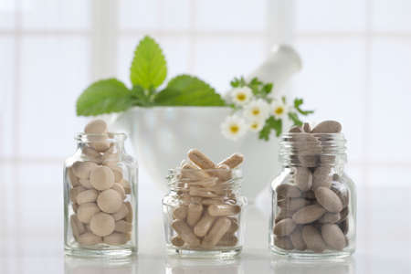 medicine bottle: Alternative health care fresh herbal ,dry and herbal capsule with mortar Stock Photo
