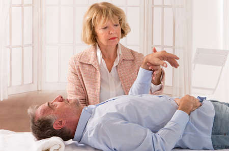 hypnotherapy: Senior man patient undergoing hypnotherapy Stock Photo