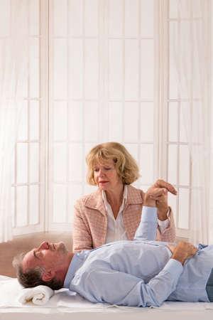 Senior male  patient undergoing hypnotherapy