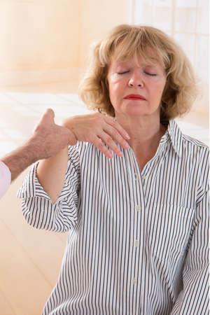 hypnotist: Hypnotist  hypnotizing a senior woman Stock Photo