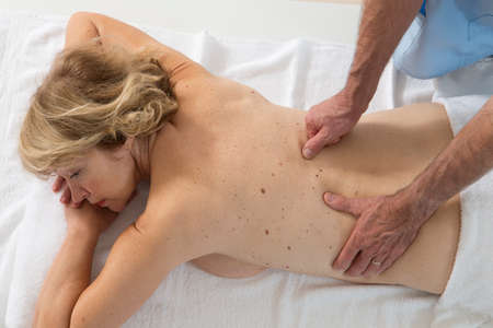 adjustment: osteopathy procedure for examining the spine