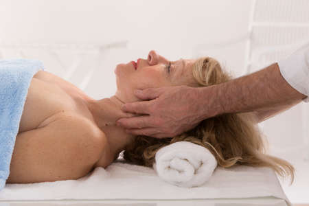 alternative healer: cranial osteopathy therapy doctor hands in woman hea Stock Photo