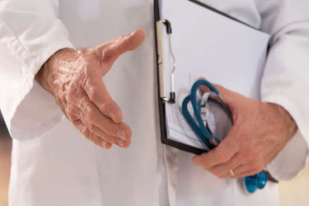 medicine: doctor woman give handshake or welcome sign gesture Stock Photo