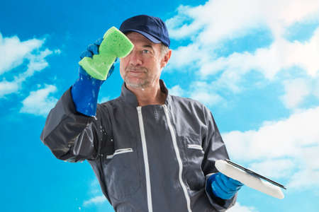 maintenance: a professional window cleaner sponge and squeegies a window clean