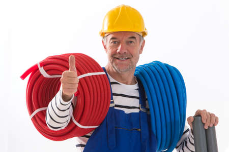 energy electrician: Electrician worker with tools on white background. Stock Photo