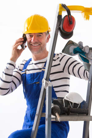 profesional: renovation profesional speaking on the phone about client order Stock Photo