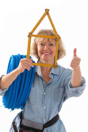 craftswoman: Craftsman and craftswoman   Holding a Symbolic House