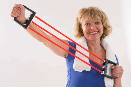 rubber band: Healthy fitness elderly woman Sport and exercise concept.