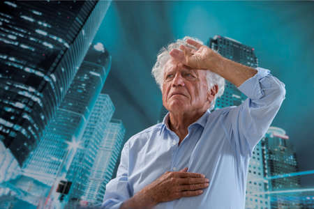 Man having a heart attack bending Reklamní fotografie