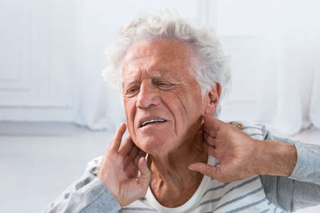 senior man on a neck pain: Senior man suffering from neck ache Stock Photo