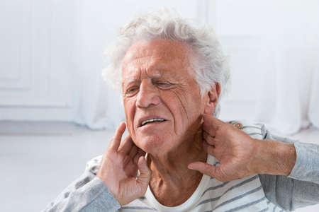 senior man on a neck pain: Senior man suffering from neck ache Stock Photo