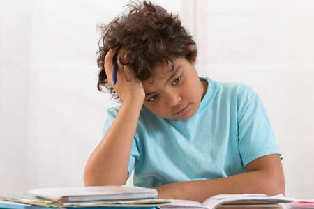 Young Boy Doing Homework In His Room