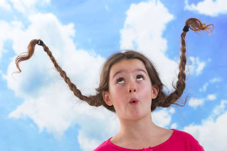 girl looking up: Playful litle girle like Pippi Longstocking Stock Photo