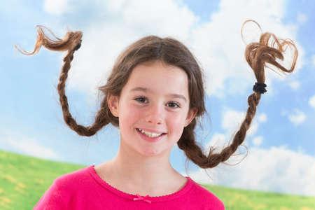 Playful litle girle like Pippi Longstocking Stock Photo