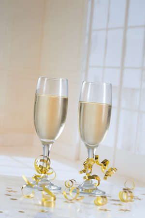shiny gold: Two champagne flutes on gold shiny background