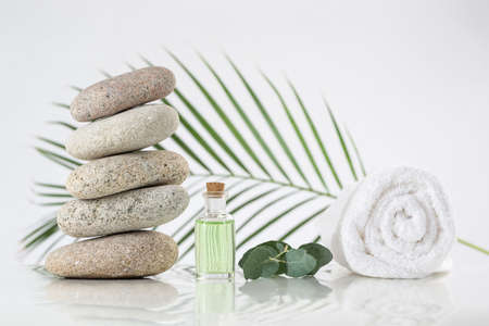 spa accessories with stones on white background