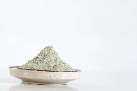 kaolin: Dead Sea mud in a bowl for cosmetic  use Stock Photo