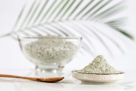 Composition with cosmetic clay for spa treatments in glass mortar Stock Photo