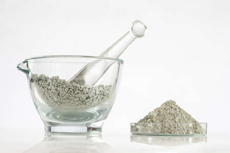 Green clay in glass mortar, Composition with cosmetic clay for spa treatments Stock Photo