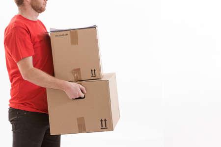 consign: deliverer holding parcels to deliver Stock Photo