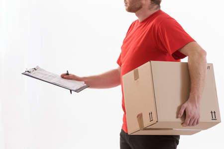 warehouseman: Portrait of an handsome deliverer holding a box