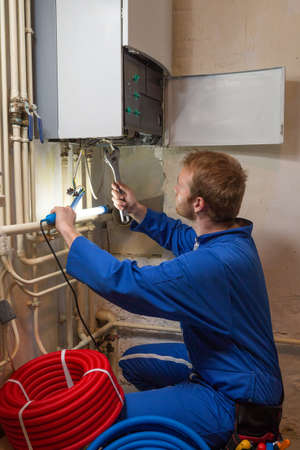 tallyman: Engineer controlling the heating pipes at the boiler room Stock Photo