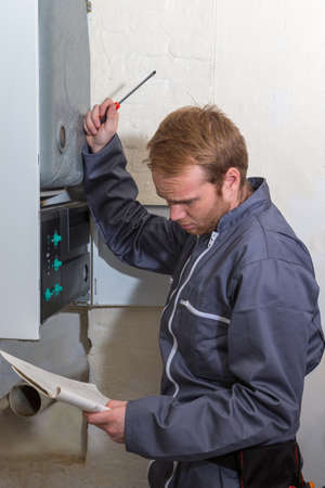 tallyman: Technician servicing the gas boiler for hot water and heating