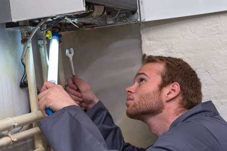 technician: Engineer controlling the heating pipes at the boiler room Stock Photo