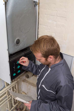 engineer: Technician servicing the gas boiler for hot water and heating