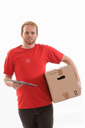 consign: Portrait of an handsome deliverer holding a box