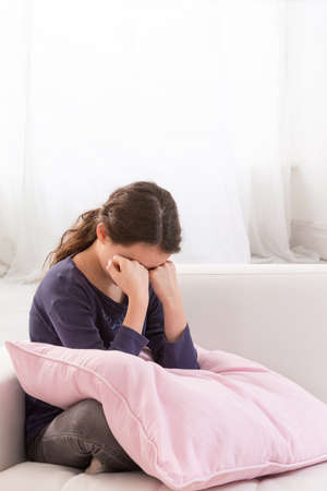 sad face: Sad and lonely girl crying with a hand covering her face Stock Photo